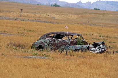 http://reviews.carreview.com/files/2009/05/abandoned-car.jpg