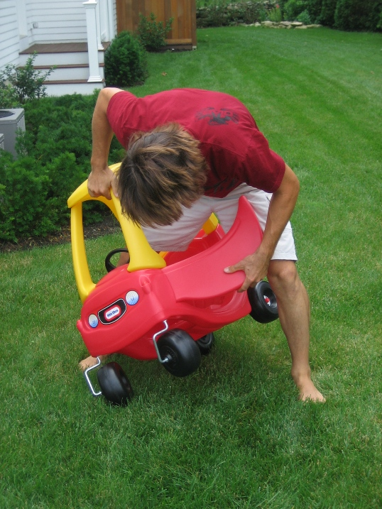 Squeezing Into A Little Tikes Cozy Coupe