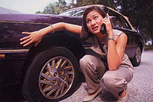 flat tire -- calling for a tow truck