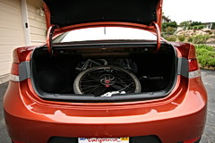 Kia Forte Koup carrying a bike in the trunk