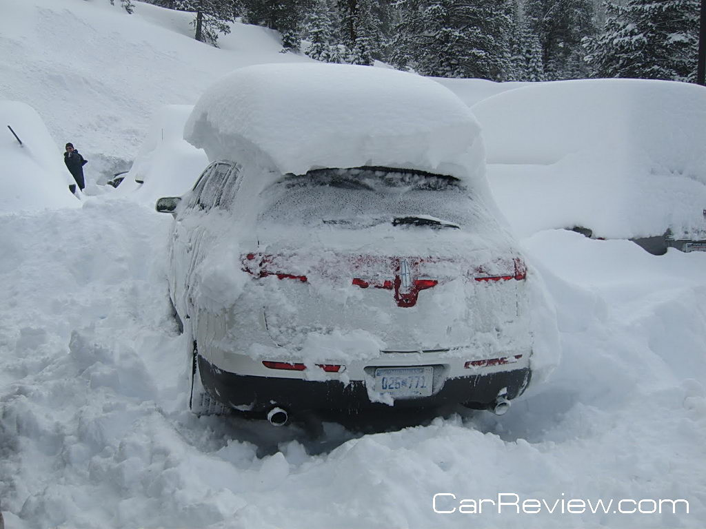 2011 Lincoln MKT buried under a pile of snow