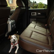 Tessa demonstrates the F-150 Supercrew rear seat and fully flat loading surface