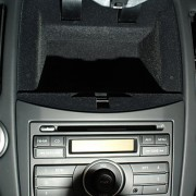 storage compartment takes over space saved for Nissan navigation system