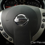 Leather-wrapped steering wheel with audio and cruise controls