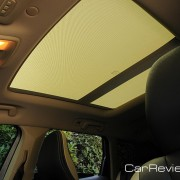 Laminated panoramic sunroof w/power sunshade