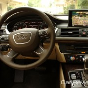 Leather-wrapped, four-spoke, multifunction steering wheel