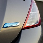 2012 Nissan Versa Pure Drive badge
