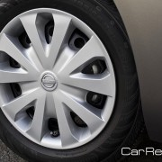 """15"""" x 5.5"""" steel wheels with wheel covers and all season tires"""
