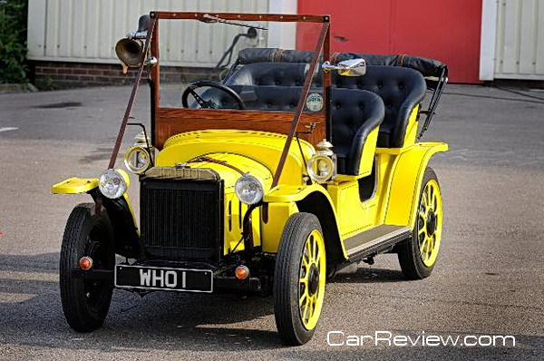 Canary yellow Edwardian vintage car with unique WHO 1 number plate